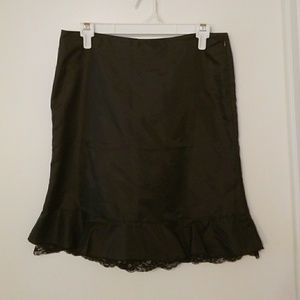 DKNY black mid length skirt with lace trim; size 7